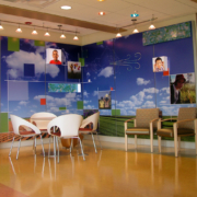 Cincinnati Children's Hospital waiting area with wall mural of fields and sky with children