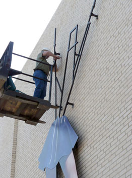 Installation of Custom Dancer's Face Sign at Kilgore College - Architectural Graphics