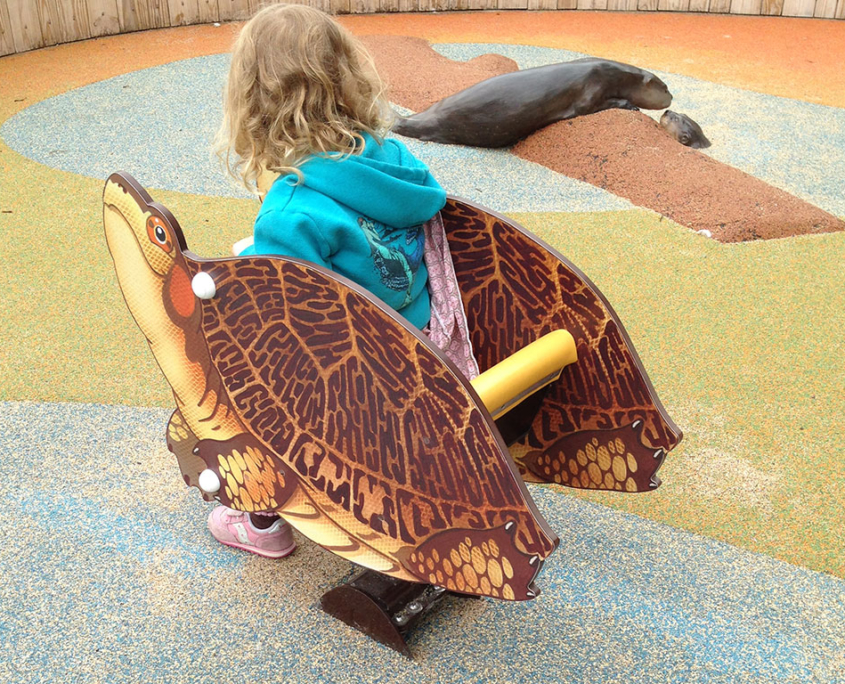 Outdoor Turtle shaped rocker in children's playground