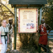 Custom outdoor park sign featuring native kenyan and staff