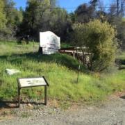 Whiskeytown NRA road side interpretive panels and old blacksmith shop