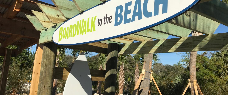 Florida Beach Resort surfboard shaped intepretive panel identity sign