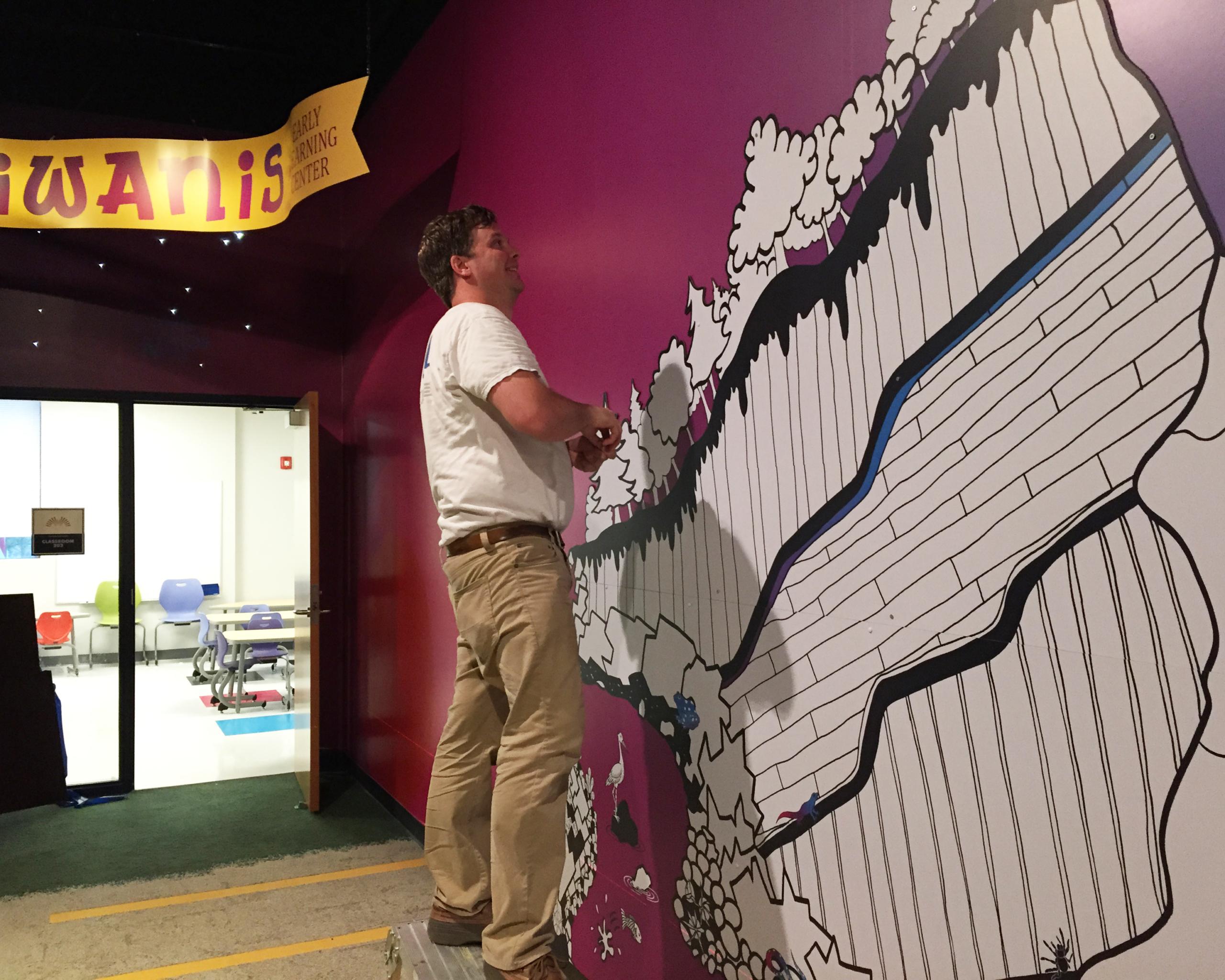 Man installing wall panel
