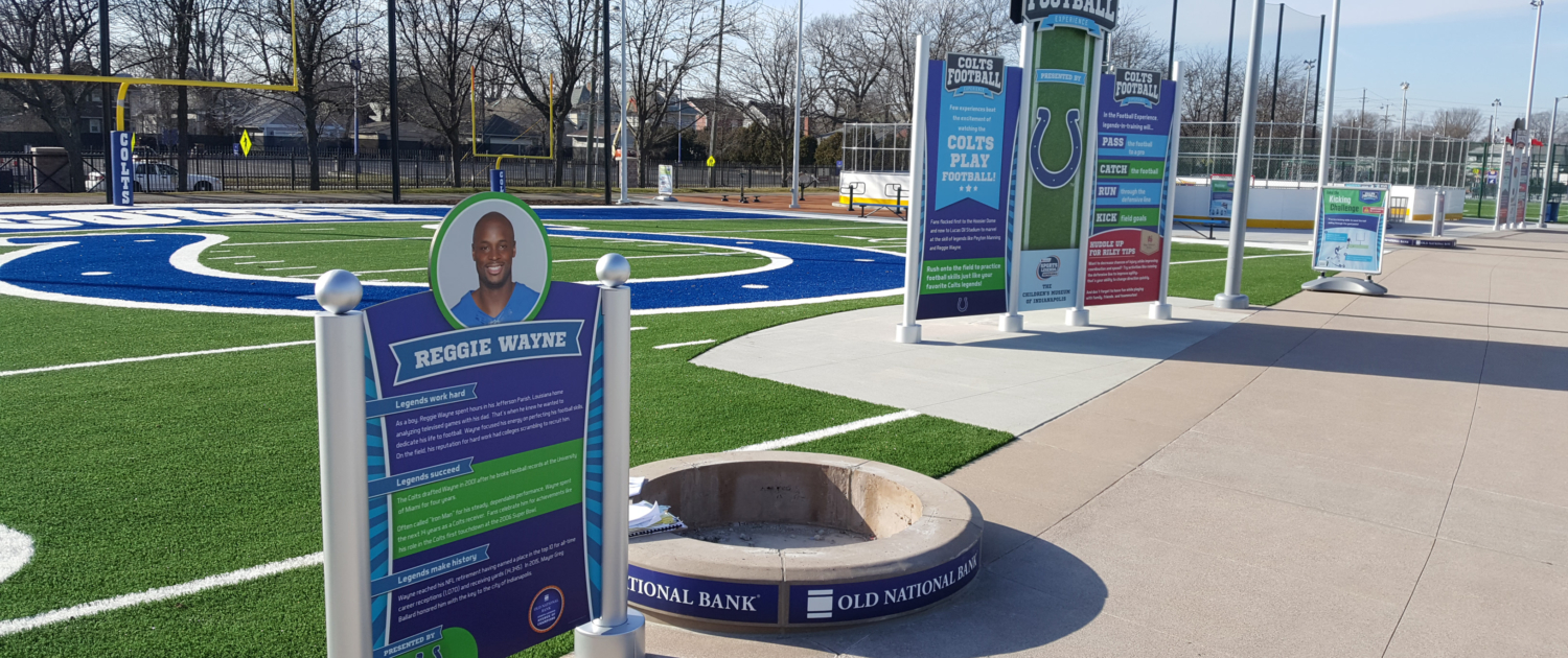 Indianapolis Children's Museum Large bright graphic panel signs in outdoor play area