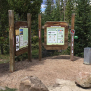 Heber Kamas Trailhead large wooden structures with wayfidnign panels attached