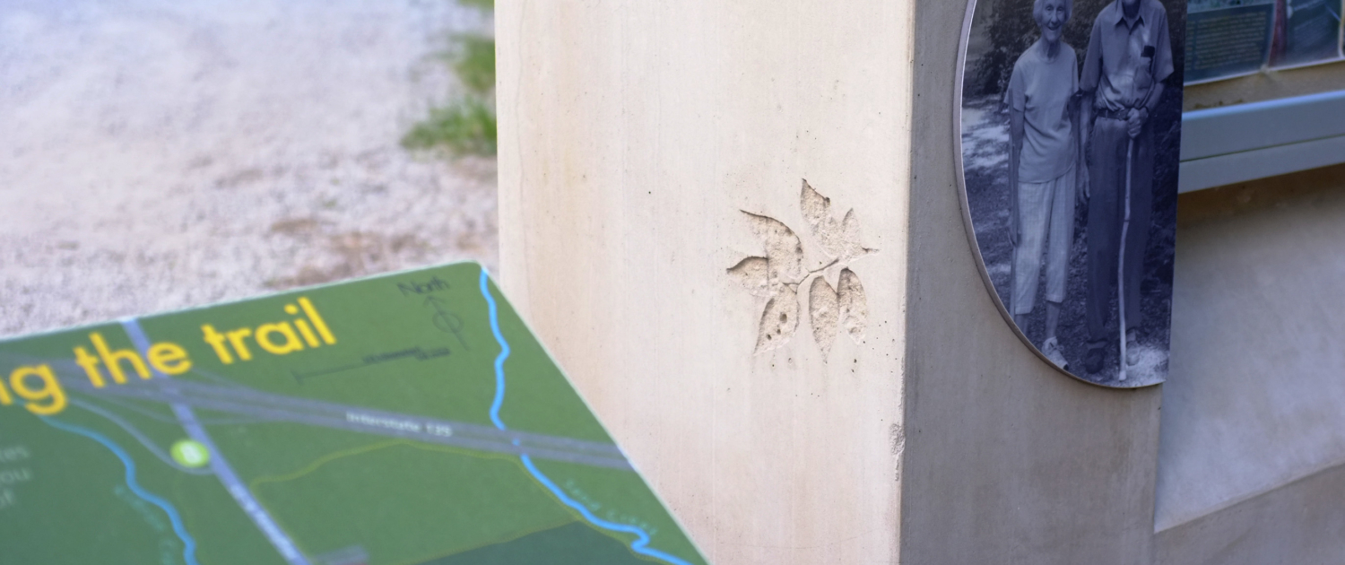 Trail Stories close up of Large concrete structures with interpretive panels attached