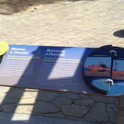outdoor zoo exhibit interpretive panel featuring flip book