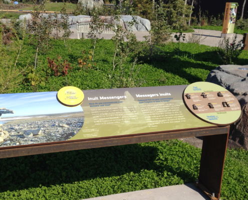 outdoor zoo exhibit interpretive panel with attached CHPL and Bronze pieces