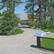 outdoor zoo exhibit interpretive panels featuring Snowey Owls and attached CHPL panels