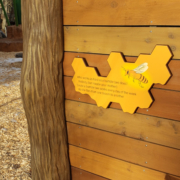 Cut to beehive shape interpretive on playscape