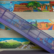 Pomeroy Elementary School wall panels near staircase featuring bright vivid cultural graphics
