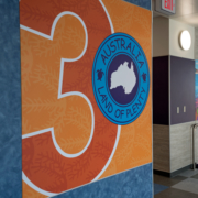 Pomeroy Elementary School wall panel featuring large number 3 and Australia logo