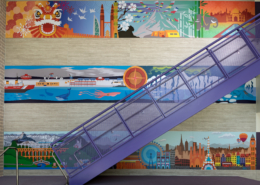 Pomeroy Elementary School wall murals near staircase featuring bright vivid cultural graphics