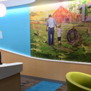 Texas Children's Hospital Wall panels in reception area featuring farm family images