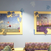 Texas Children's Hospital puzzle like wall panels featuring kites and puzzle pieces attached seperately of the main panel