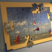 Texas Children's Hospital puzzle like wall panel featuring kites and puzzle pieces attached seperately of the main panel