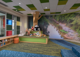 Thornton Elementary School Wall mural in childens library featuring a stream