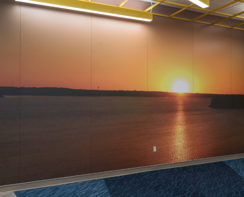 Thornton Elementary School wall mural featuring sunset over water