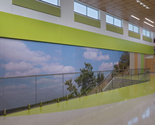 Thornton Elementary School wall mural beside staircase featuring Texas native landscapes