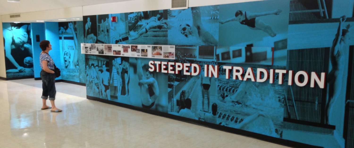 UT Swim Center Large wall mural featuring past swim team members with blue overlay